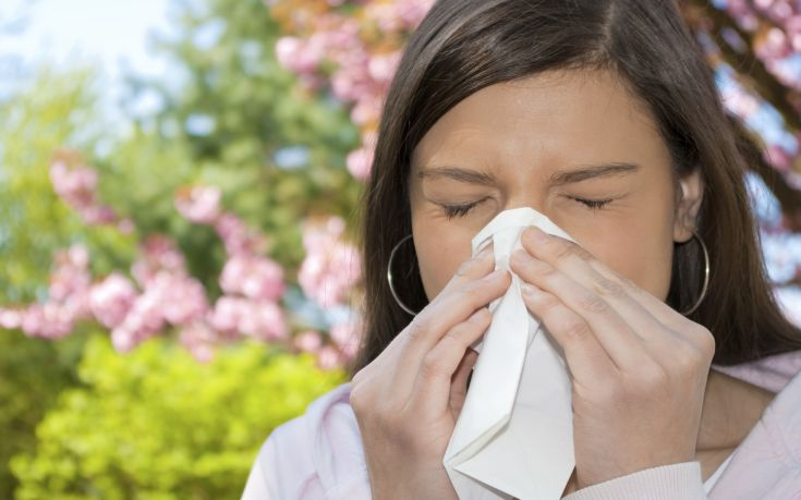 woman sneezing 1